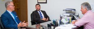Insurance cluster advisor talks with agency
